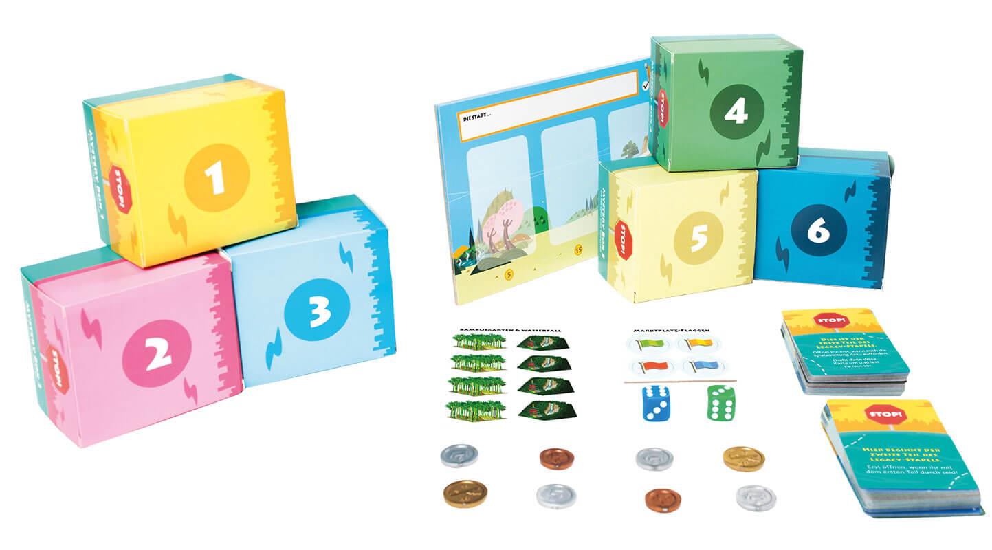 Geheimnisvolle Boxen & schönes Spielmaterial - Legacy-Variante des Erfolgspiels- Machi Koro Legacy